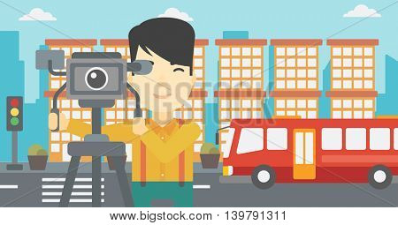 An asian young cameraman looking through movie camera on a tripod. Young man with professional video camera in the city. Vector flat design illustration. Horizontal layout.