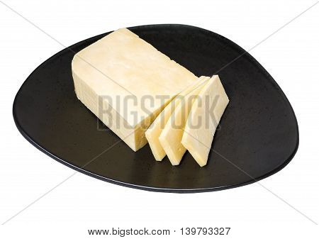 Oriental cuisine, paneer indian homemade white unsalted cheese on dark ceramic dish, isolated on white