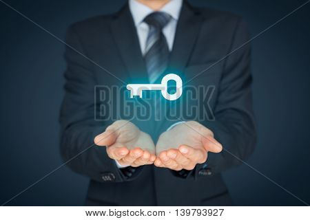 Businessman offer key to success or solution. Turnkey solution and services concept.