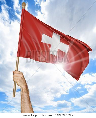 Person's hand holding the Swiss national flag and waving it in the sky, 3D rendering