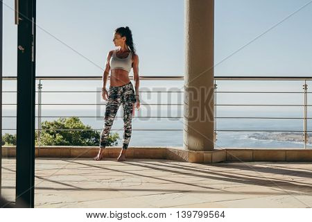 Fit Young Woman Standing In The Balcony