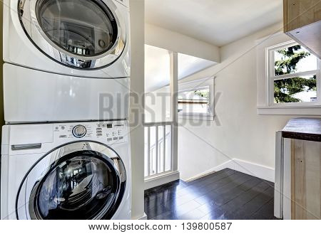 Laundry Room With Modern White Appliances