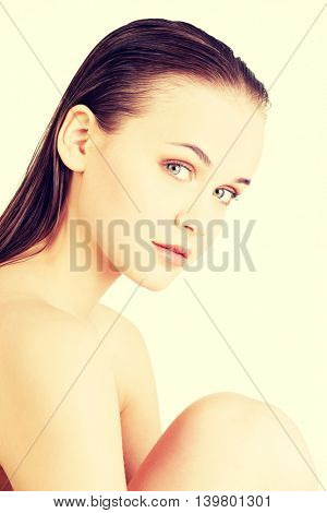 Attractive naked caucassian woman's portrait.
