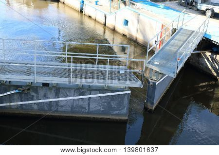 Detail photo of opening river lock - water navigation - a device used for raising and lowering boats gate are opening; Labe Podebrady Czech Republic