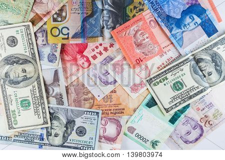 Multiple currency banknotes as colorful background showed the global money financial business economy crisis due to British out of European Union