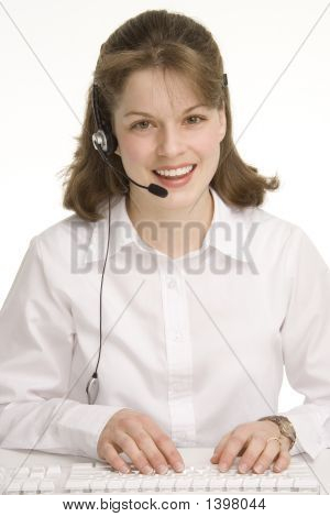 Operador de la mujer, Keybording/teclear con audífonos