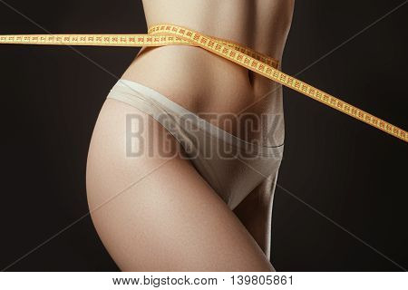 Woman Measuring Perfect Shape Of Beautiful Thigh. She Lose Weigh