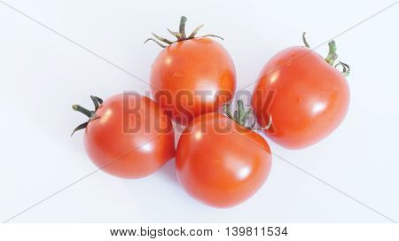 Red ripe tomato on a white background