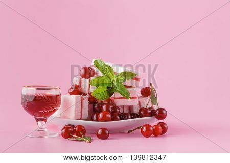Cherry Liquer And Sweets On Pink Background