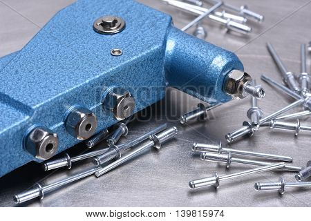 Hand rivet tool on metal surface on the metal