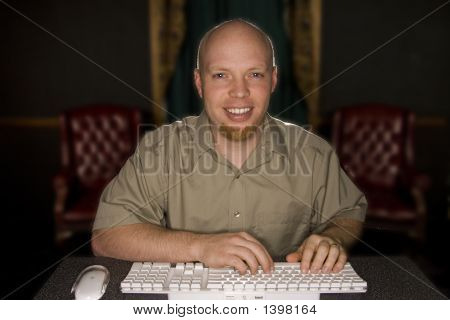 Happy Man On His Computer
