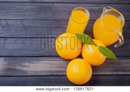 orange juice in the jug on the table close up