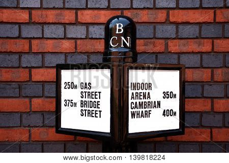 BIRMINGHAM, UNITED KINGDOM - JUNE 6, 2016 - Metal Birmingham canal navigation sign against a brick wall Birmingham England UK Western Europe, June 6, 2016.
