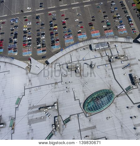 Supermarket Roof And Many Cars In Parking, Viewed From Above.