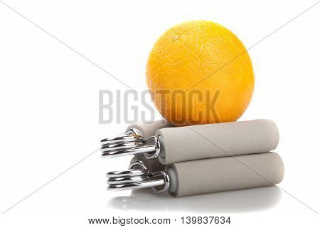 orange on two carpal expander isolated on white fitness concept