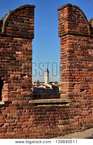 San Zeno Basilica viewed through Scaliger Bridge medieval battlement in Verona