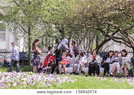 St. Petersburg, Russia - 9 May, People vacationers relax in the garden, 9 May, 2016. Vacationers people on the lawns and gardens in the city.