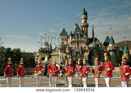 Hong Kong China - December 13 2005: Hong Kong Disneyland marching band and the Sleeping Beauty Castle