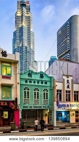 Boat Quay District And Uob Plaza In Singapore