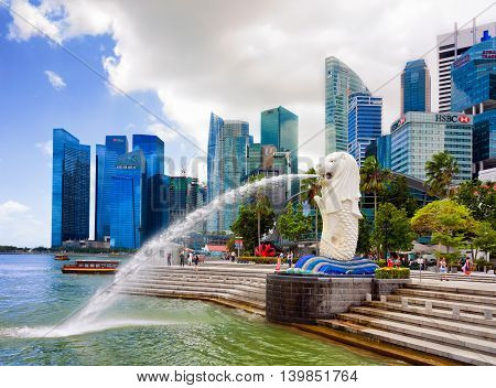 Skyline And Merlion Statue At Merlion Park In Singapore