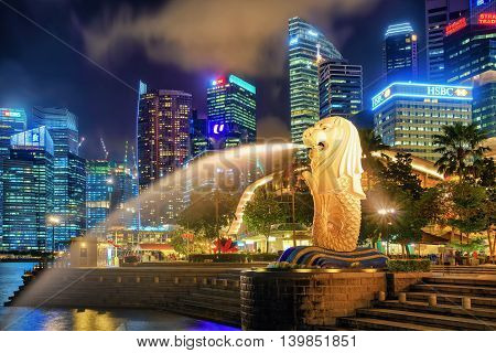 Skyscrapers And Merlion Statue At Merlion Park In The Evening