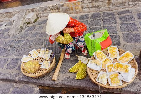 Asian Woman Selling Flesh Of Cleaned Durian In Vietnam