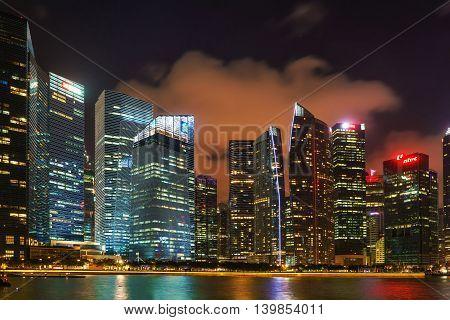 Singapore Skyline On Downtown Core At Marina Bay At Night