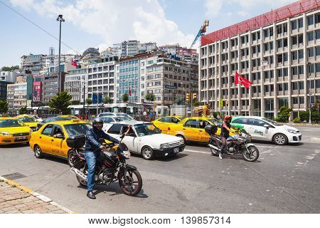 Cars And Motorcycles Wait On Istanbul Street