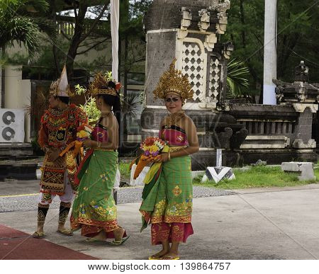 Port Benoa Bali Indonesia--Feb 28 2016 Dancers in traditional Balinesian costumes greeting tourists at Port Benoa / Bali Indonesia