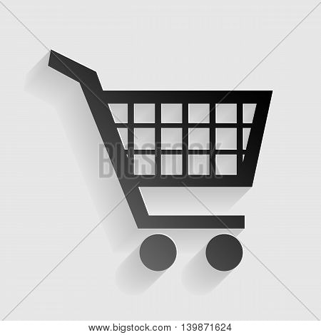 Shopping cart sign. Black paper with shadow on gray background.