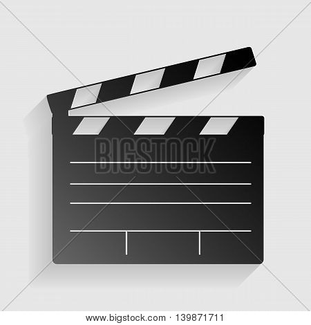 Film clap board cinema sign. Black paper with shadow on gray background.