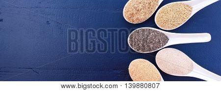 Assorted Grains On Dark Wood Table.