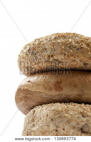 whole wheat and multigrain bagels isolated on white background