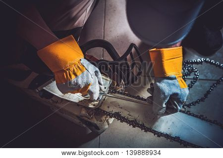 Replacing Wood Saw Chain Closeup Photo. Fixing Gasoline Chain Saw