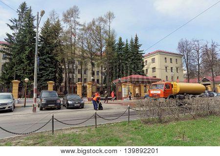 Nizhny Novgorod Russia. - April 26.2016. Janitors clean the garbage the street in front of the prosecutor's office of the Nizhny Novgorod region.