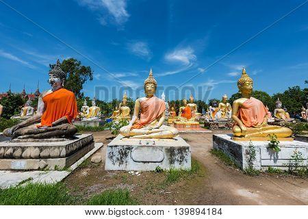 Many Budddha Statues Against Blue Sky