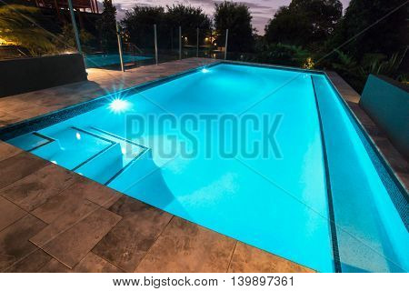 Blue Water Swimming Pool With Flashing Lights With Floor Tiles