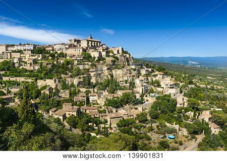 Village of Gordes in Luberon land during a sunny day