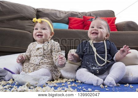 introducing food to baby happy twin babies making a mess