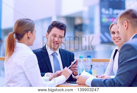 Group of happy young business people in a meeting at office