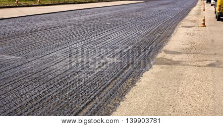 Close-up Of The Process Of Repair Of The Road Paving Road Asphalt