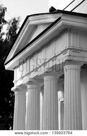 Pediment of Fragment of Church of St. Alexander Nevsky in Ust-Izhora town St.Petersburg suburb Russia. Black and white.