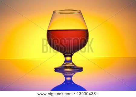 brandy and cognac glass with yellow background