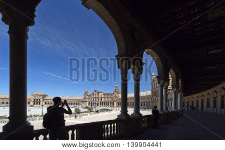 SEVILLE, SPAIN - September 13, 2015: Tourists at the Plaza de Espana (Spain Square) on September 13, 2015 in Seville, Spain