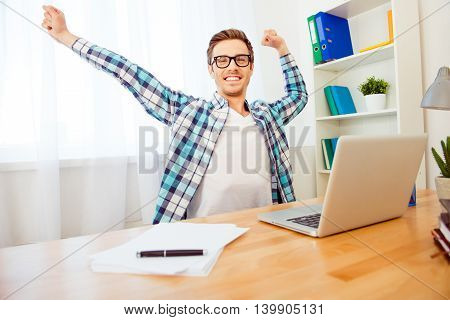 Handsome Smiling Man In Glasses Stretching Hands After Working Day