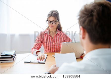 Man And Woman Working At Office With Laptop And New Contract