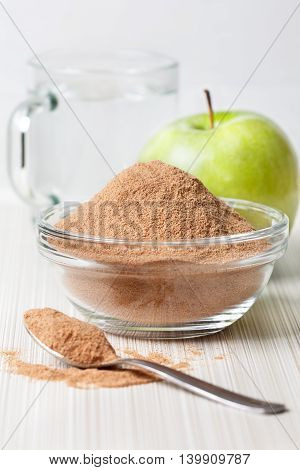 crushed apple fiber green apple on a light background. dietary product