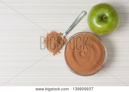 crushed apple fiber apple green on background with space for text (top view). dietary product