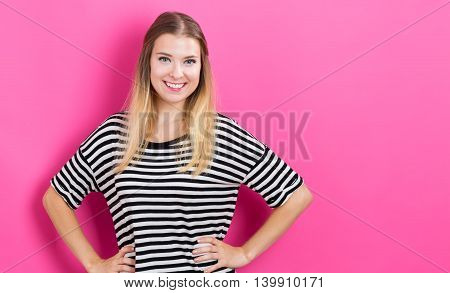 Happy Young Woman With Pink Background
