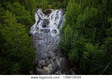 Eagle River Waterfall In Michigan. Eagle River Falls is one of the largest waterfalls in the Keweenaw and is view able from the road. The falls are located in the town of Eagle River in Michigans Upper Peninsula.